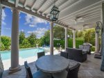 Covered Patio with Pool and Ocean Views at 10 East Wind